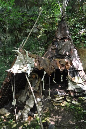 Stone age- once man started seasonal living their homes were tee-pee shaped tents covered with animal hides or bark and wood. Designed  so the frame would remain, for next time and the tent  packed up and taken with them.