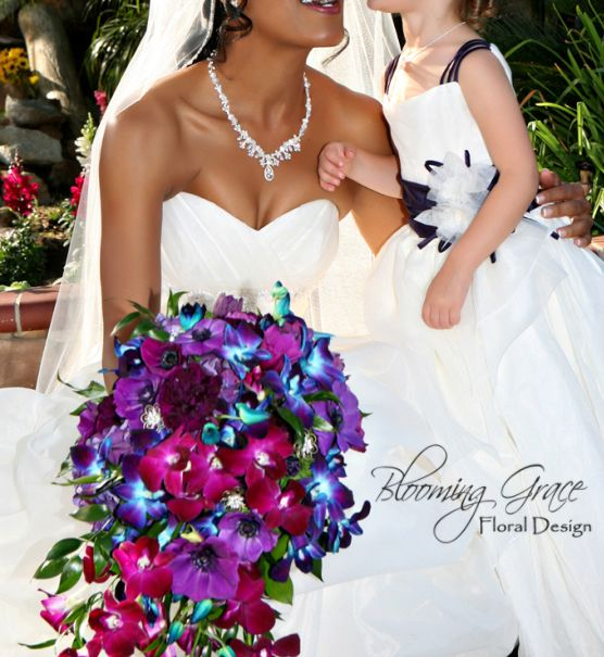 Cascade wedding bouquet with purple, blue, and magenta orchids Shadowcatcher Imagery