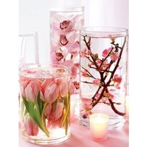 Centrepiece idea only on a mirror with candles like tea lites surrounding it!