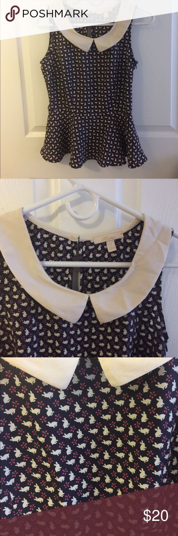 """Navy Monteau peplum top with peter pan collar Super cute and whimsical navy blue peplum top with a bunny and floral print. It has a cream colored peter pan collar and a side zipper. It has belt loops for a skinny belt, but it does not come with a belt. Lying flat it Measures 17"""" across at the bus and 13"""" at the waist. This is a reposh. It was too small, but i loved it so much I bought a larger size. Monteau Tops"""