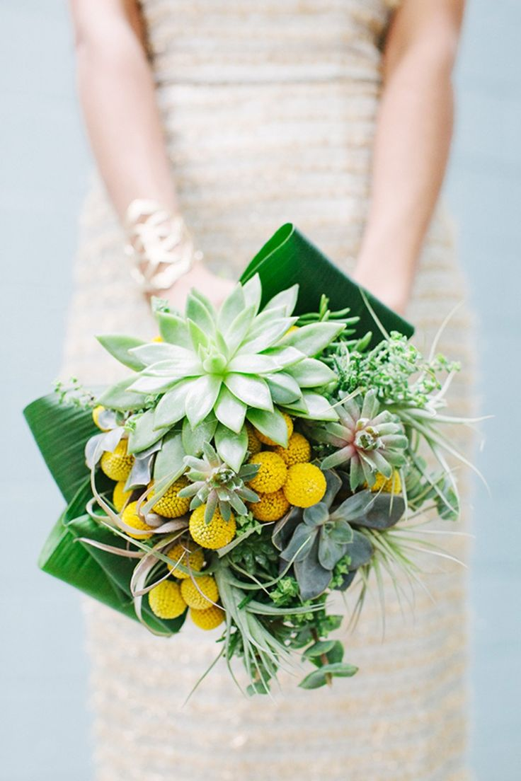 Amazing green and yellow bridal bouquet with succulents, air plants and billy balls by Holly Chapple. Photo by Katie Stoops. Fashion by Rent the Runway. Design by Bellwether Events. See more here: http://www.bellwetherevents.com