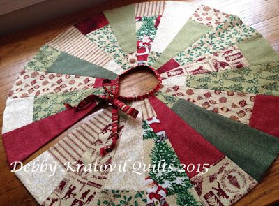Christmas Tree Skirt using Holiday Homespun fabrics. Free template for the wedges and tutorial on how to make this using a fat quarter bundle.