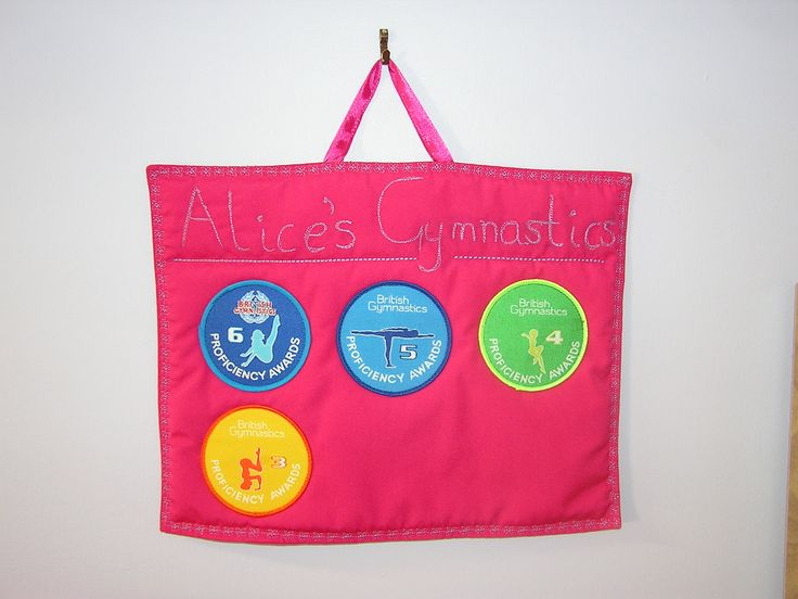 Designed this wall-hanging to display my daughter's well earned gymnastics badges.