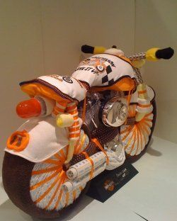 Unique diaper cakes - haven't looked through them all, but I wish I knew somebody having a boy for that freaking motorcycle!