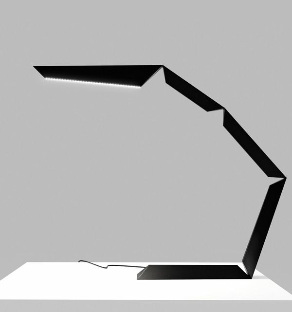 Phalanx LED Table Lamp by Michael Samoriz. The lamp's silhouette appears almost…