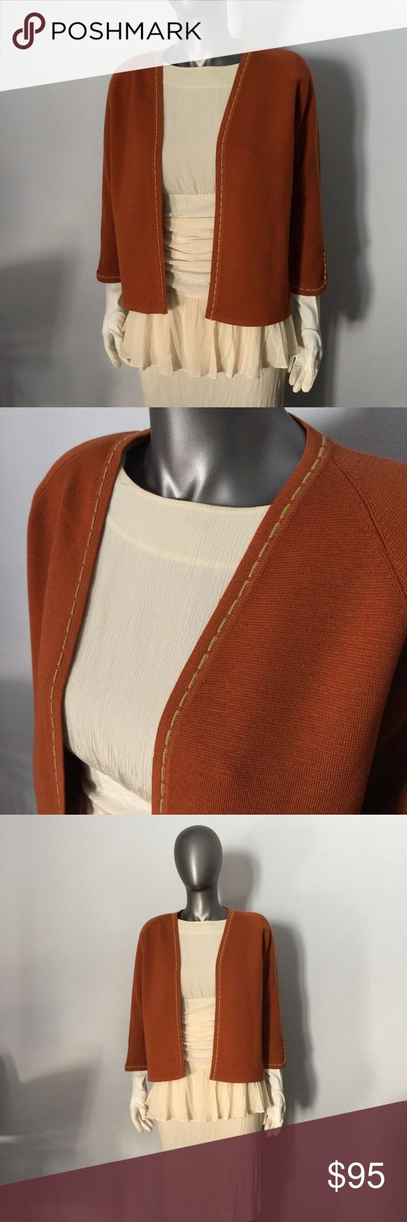 """VINTAGE Helen Smith of Pasadena Wool Cardigan VINTAGE 'HELEN SMITH OF PASADENA' Cardigan Sweater in a beautiful rustic burnt orange color with mustard yellow stitching around the collar, front, as well as sleeves. 100% Wool. Made in Italy. From the 1960's.   SIZE: No size tag (approx Medium)  APPROX MEASUREMENTS: 19"""" (pit to pit when Sweater is laid flat) 22.75"""" (top of shoulder to bottom hem)  CONDITION: Excellent Vintage (no stains, no rips, no tears) (Near Mint Condition)  ***NOTE: Dress…"""
