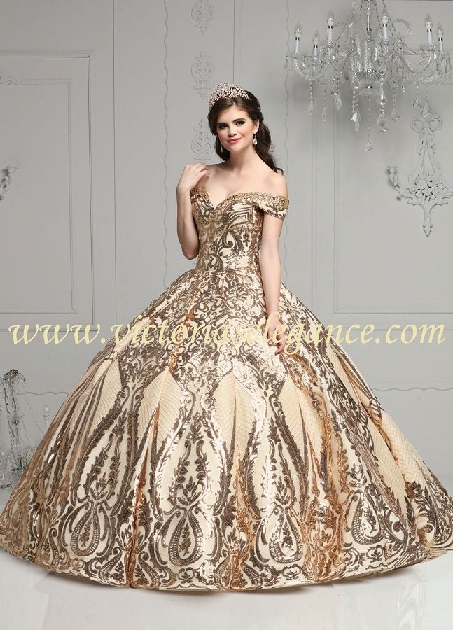12d32bf4e44 Stunning ball gown with gold metallic sequin designs over tulle