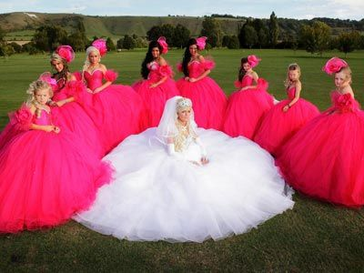 BAHAHA!!!!  The sad thing is... I would totally have my bridesmaid dresses wear big poofy dresses like this if it weren't completely looked down upon!  haha!  And my girls would KILL me if I made them wear these!  SO I would never...but you gogtta admit it's funny!