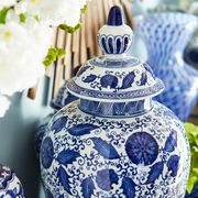 "Inspired by 14th century Chinese ""general jars"" used to carry salt, spices, rice and ashes, our decorative ceramic temple jar delivers a mighty dose of Asian style. Hand-painted botanic patterns in cool shades of cobalt cover this <i>objet d'art</i> from foot to lid, resulting in a striking conversation piece that can stand alone or mingle with other jars of varying sizes."