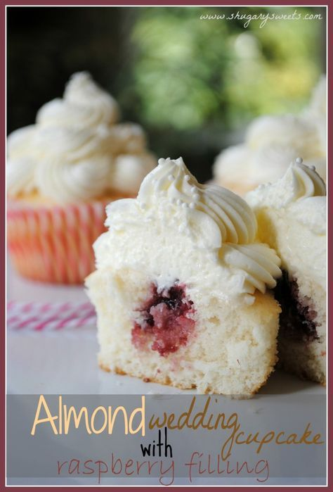 Almond cupcakes with Raspberry filling: the perfect wedding cake cupcakes! ...Not always so fond of fruit filling in cake, so may try an almond buttercream filling