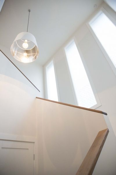 Modern Staircase Contemporary Weatherboard Home on a sloping block.