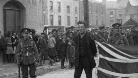 1920 - Two Irish civilians forced to parade around a Waterford town by British troops with a British flag tied around their necks. Both men were beaten and dumped outside the town. The War of Independence, Ireland, 1920