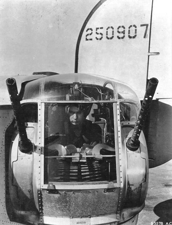 Sergeant Otto A. Sobanjo 755th Bomb Squadron sits in the tail turret of B-24J Liberator Lily Marlene at RAF Horsham St Faith Norfolk England UK August 1944.