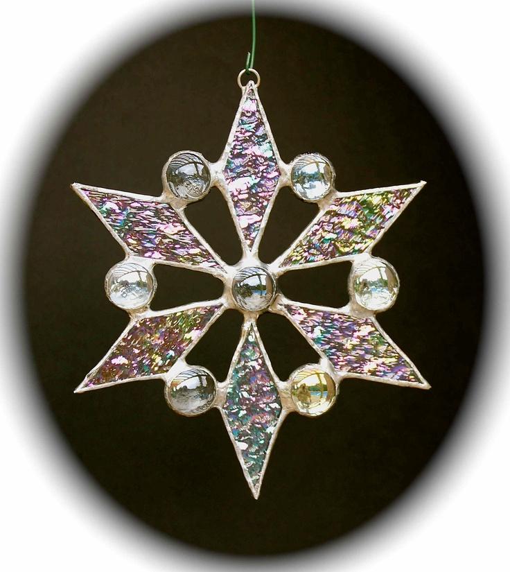 stained glass snowflake suncatcher (design 5). $15.00, via Etsy.