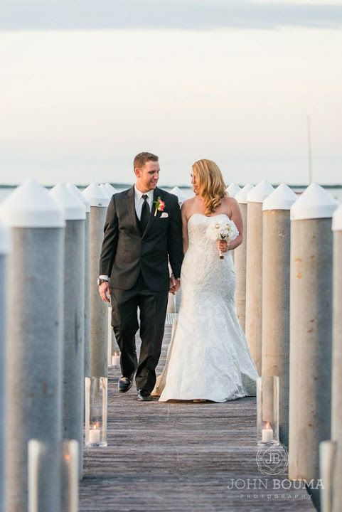 Newly Weds Taking A Walk By The Deck Passionate Sunset Breeze At Key Largo