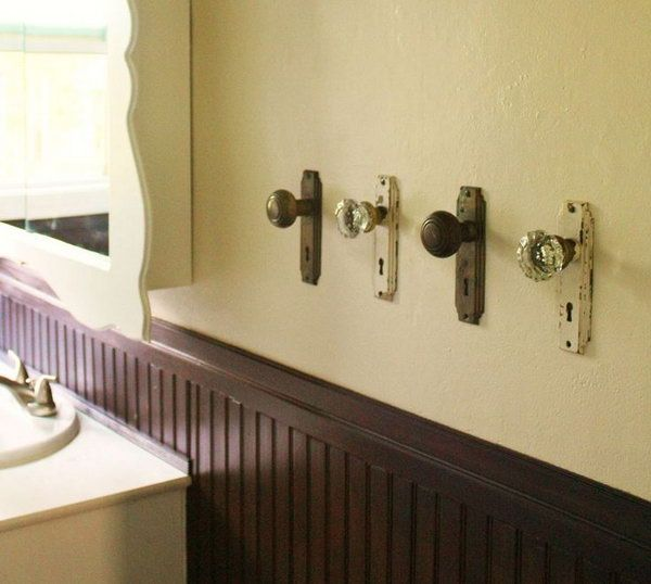 Use doorknobs to hang towels. Recycle your old doorknobs and install them on the wall for hanging towels or clothes.