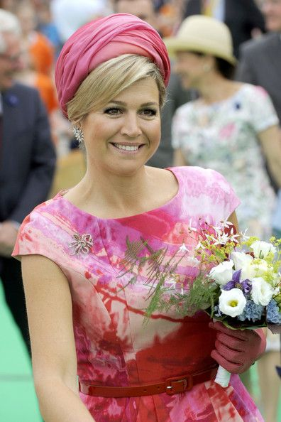 Queen Maxima of The Netherlands seen flaring flag at the 750th anniversary of Goor during an official visit to the town centre at Heerenbroek in Netherlands