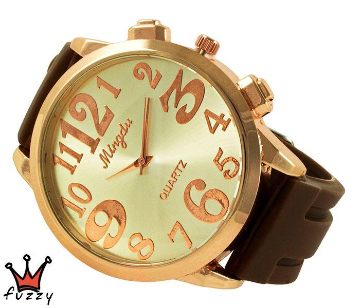 Γυναικείο ρολόι, με κάσα σε ροζ χρυσό και εκρού περλέ εσωτερικό καντράν.Μεγάλα νούμερα σε ροζ χρυσό στο εσωτερικό του.  Λουράκι σε καφέ, από σιλικόνη. Διάμετρος καντράν 48 mm