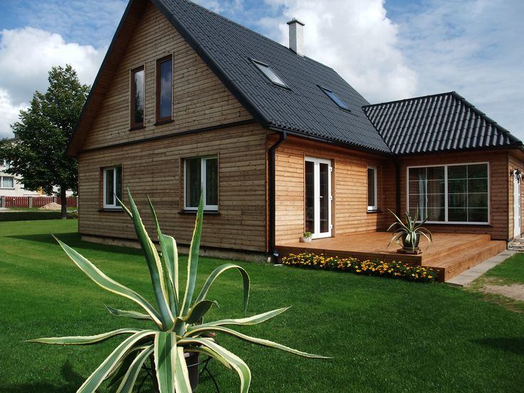 """Another picture of house with black """"Gotika"""" corrugated sheets."""