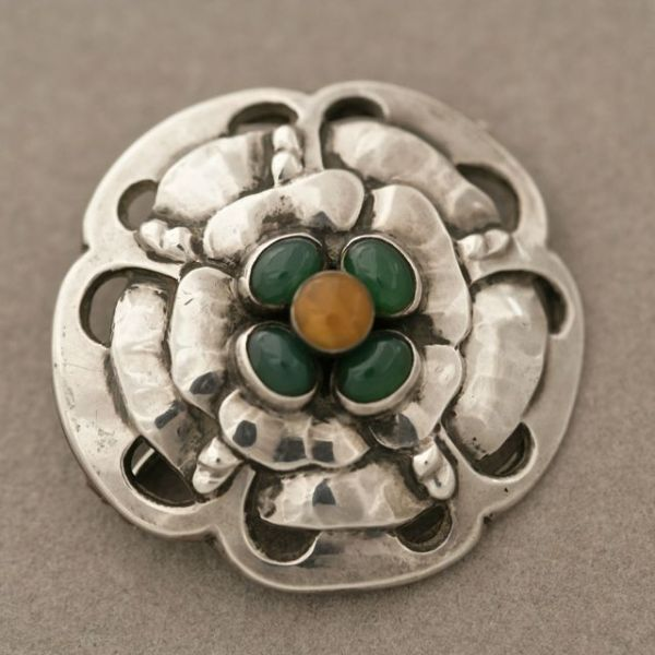Brooch | Georg Jensen.  Handmade; sterling silver with amber and chrysophase.  Design no 9 | ca. 1904 - 1908