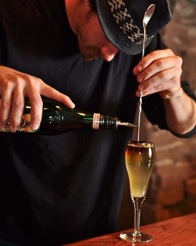 The Bitter End: whiskey, Domaine De Canton, fresh lime, and Prosecco, topped with Fernet Branca