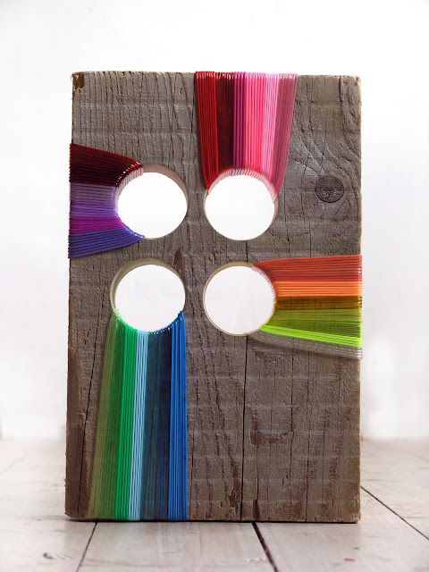 Ella Robinson works with driftwood and found objects, along with JUICY COLOR - Wrapped threads on driftwood here