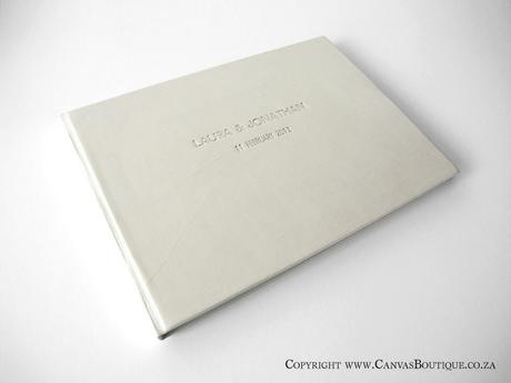 Laura & Jonathan's guestbook has a leather cover and is embossed and foiled in silver on the front - Canvas Stationery Boutique