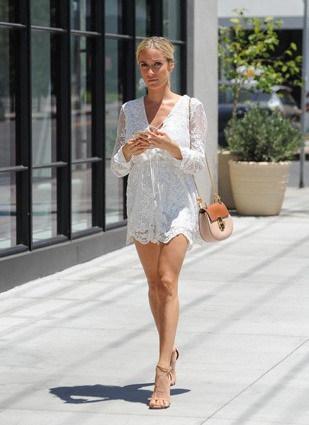 Kristin Cavallari Strappy Sandals - Kristin Cavallari lengthened her gorgeous pins with a pair of nude skinny-strap heels.
