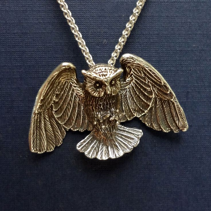 Great Horned Owl pendant is a handmade, sterling silver, realistic, life like 3-D owl.  Our animal jewelry is made in USA.
