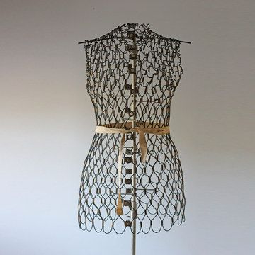 From the sale page:  Full wire dress form with metal base. Not adjustable; for display purposes only. This gently used vintage product is in good condition. Ribbon not included.  My thoughts:  for six hundred dollars retail, they couldn't toss in the ribbon?  and, it IS adjustable, unless it is rusted solid.  You scrunched all that wire together to make it fit.