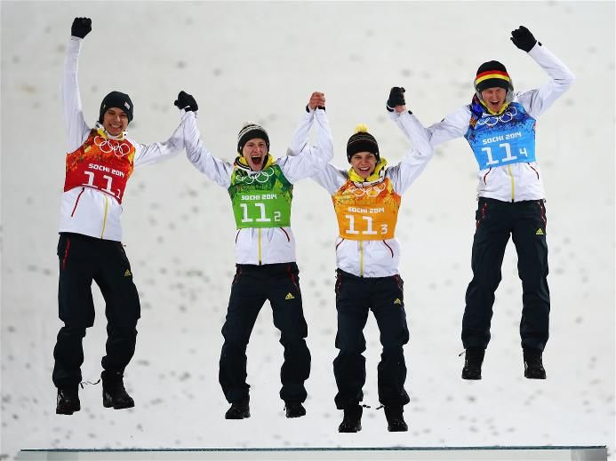 Gold medalists Andreas Wank, Marinus Kraus, Andreas Wellinger and Severin Freund of Germany celebrate during the flower ceremony for the Men's Team Ski Jumping final round on day 10 of the Sochi 2014 Winter Olympics at the RusSki Gorki Ski Jumping Center