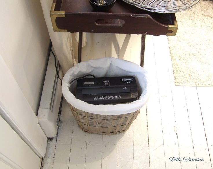 A small lidded hamper is the perfect way to hide paper shredder in plain site. Put it at your front door so the junk mail gets tossed immediately!