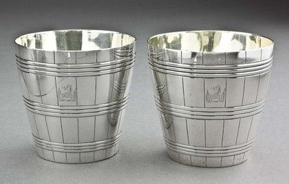A very fine pair of Georgian silver barrel shaped beakers by the well known Bateman family; Peter, Ann and William. The beakers are patterned as half barrels, complete with individual staves and the hoops to hold them in place. This set is not intended to fit together to form a single barrel, as is sometimes the case with this form, they do not have the push-fit rim, and the crests are both aligned the same way (one crest would have been reversed if intended to fit together). The beakers are…