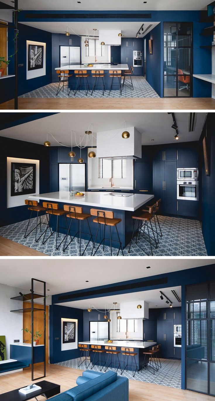 This kitchen has a palette of saturated blue cabinets, with white countertops.