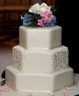 Hexagonal Shaped Wedding Cake - Choosing a unique cake shape, such as a hexagon, gives it more distinction than classic round cakes. Offsetting the tiers is another way to add a touch of the unusual to your wedding cake.