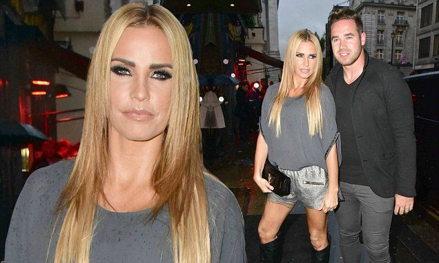 Katie Price shows off her tanned legs at book launch