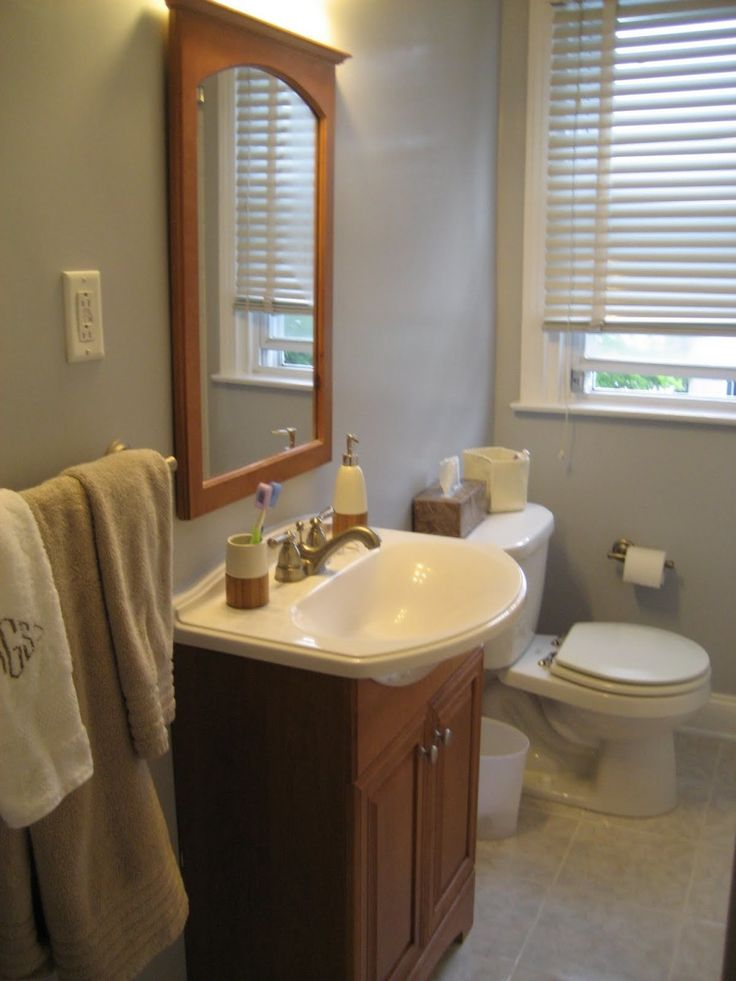 curvy white sink on brown wooden vanity