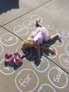 site word twister. im gonna try this, but am in love wtih the way this little girl figured out how to touch her words.
