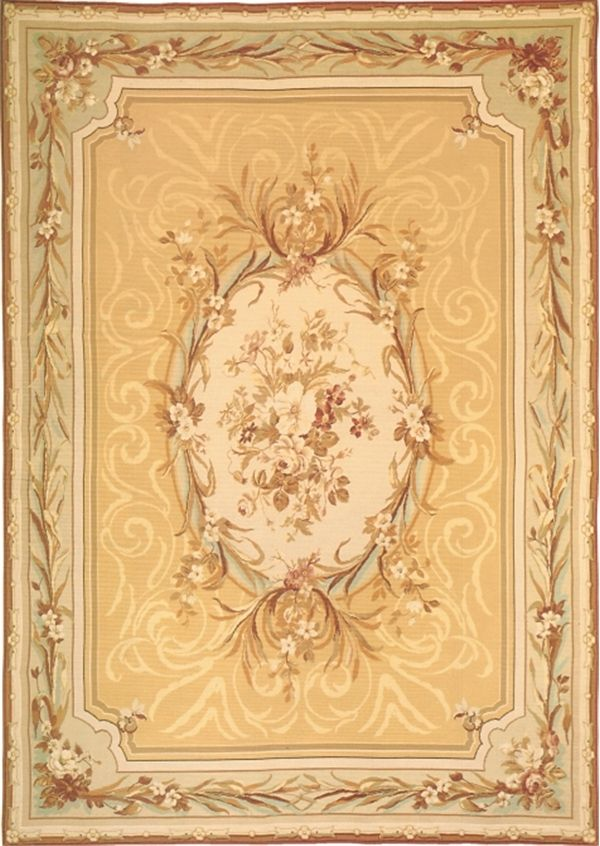 The soft golds, ivory and aqua greens and graceful scrolls of the Giselle Aubusson rug signified the peak of elegance.