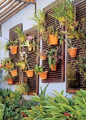 put some old shutters on the barn windows and put potted plants on them... vertical garden
