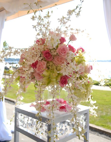 Wedding Ceremony Floral Decor - Rented Elegance: This could be used at the church along side the alter, then at the reception next to the head table (one on each side of course).