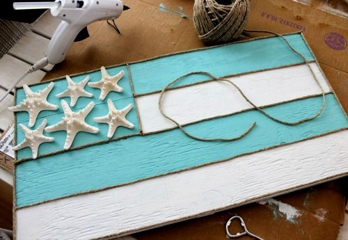 DIY aqua and white flag sign with starfish: http://www.completely-coastal.com/2016/02/beige-aqua-beach-decor.html