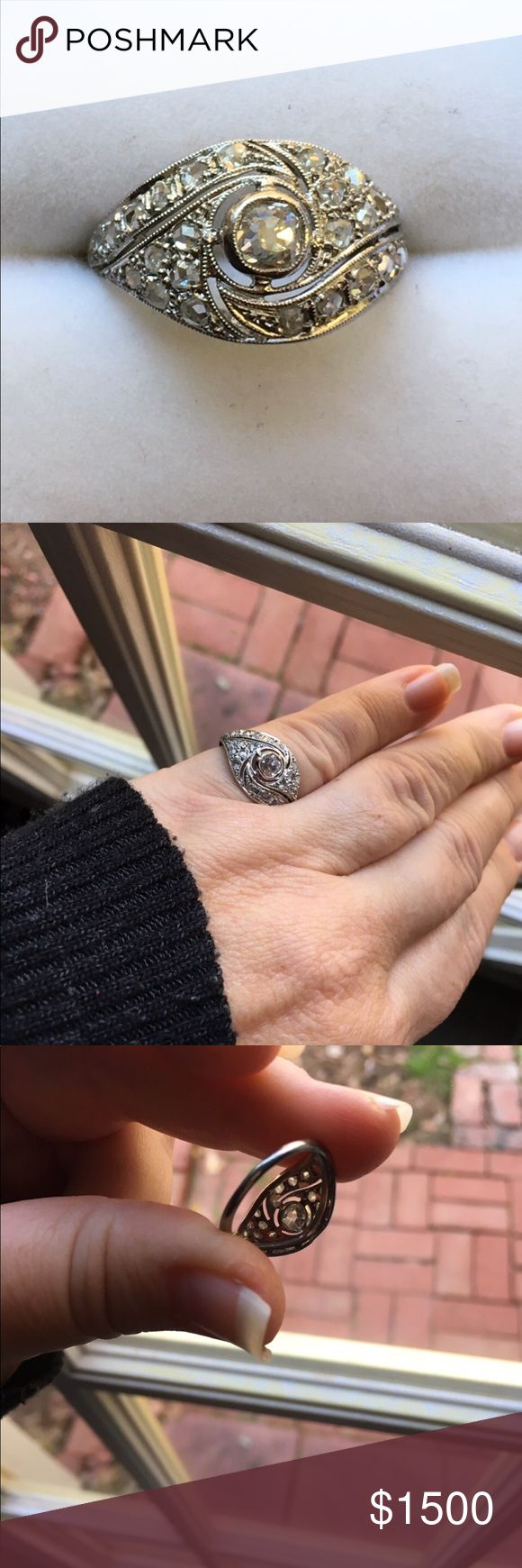 ANTIQUE  Diamond and Platinum ring A stunning Estate piece with a .67 karat Olde Mine cut Diamond(1890's) dates back to the early 1920's where it was first cast and placed. Vintage Jewelry Rings
