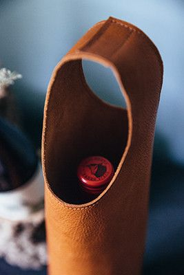 The classiest gift, your favorite vintage in a handmade in a handmade leather wine tote bag.