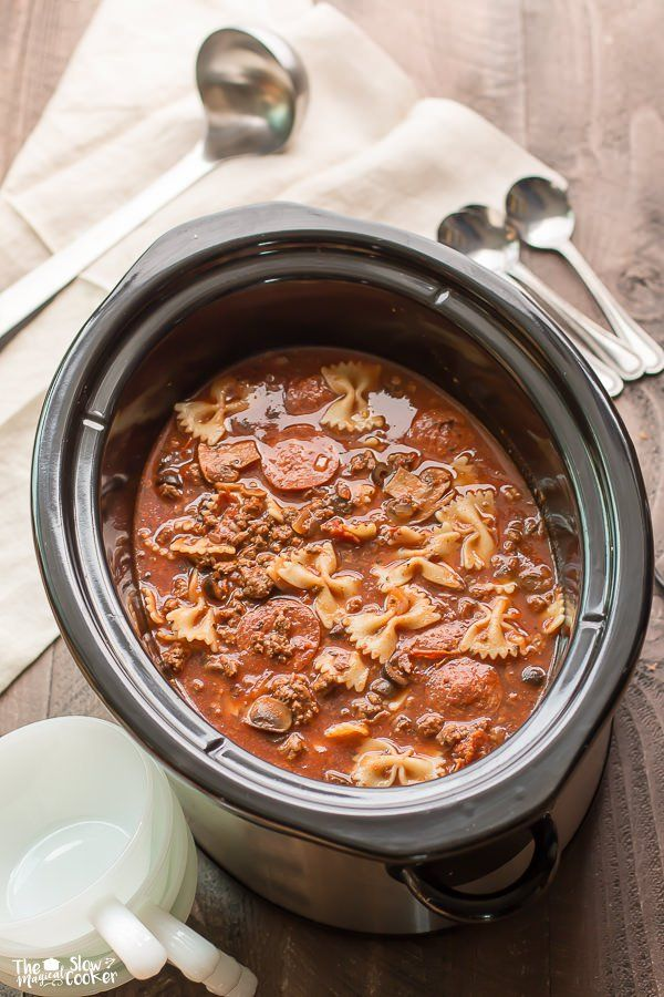 Slow Cooker Pizza and Pasta Soup is a meal your whole family will love! This Hearty Soup has pizza supreme flavors with bow-tie pasta