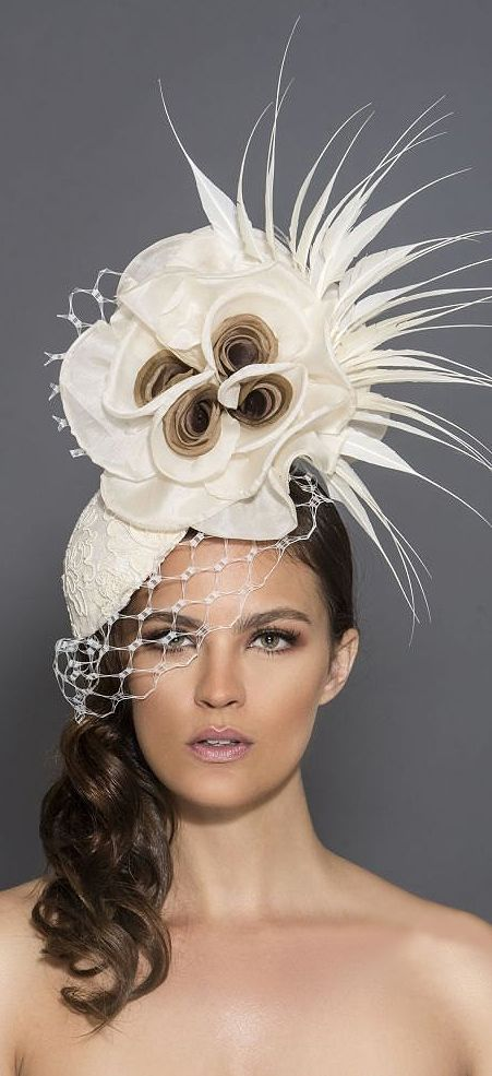 From the Arturo Derby collection, there is this beautiful cream and brown fascinator. A round base covered with a light cream french lace, adorned with 2 silk roses with brown in the center, cream feathers and hexagonal netting. Perfect for a day at Royal Ascot, Dubai World Cup, Melbourne Cup, or Kentucky Derby #millinery #fashionsonthefield #racingfashion #kentuckyderby #weddings #florals #floralfashion #affiliatelink #handmade