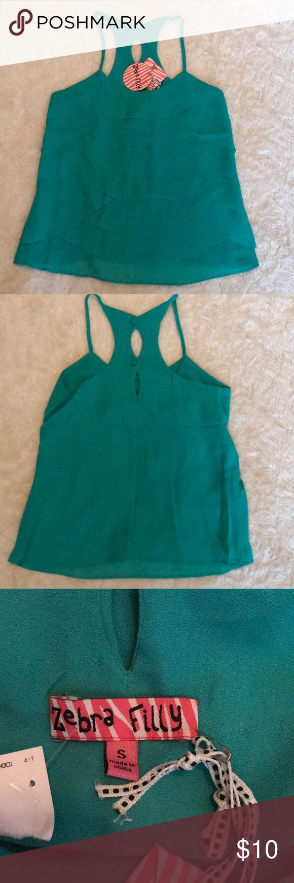 NWT Zebra Filly Girls Top Sz Small Super cute girls Top by Zebra Filly. Pretty green with ruffled front overlay. NWT!!  Check out my closet and bundle! Would look great with the DKNY white denim I have for sale! Zebra Filly Shirts & Tops