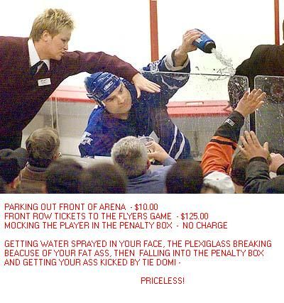 Tie Domi, man. Good times. Maybe not for the guy who fell into the penalty box. But he was a Flyers fan. It's all good.