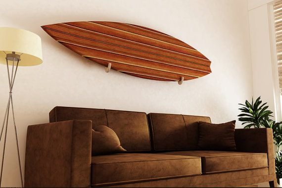 Surfboard racks for wall mounting. Great item to safe space and show off your board.  Handmade out of recycled wood.  Protective neoprene tape