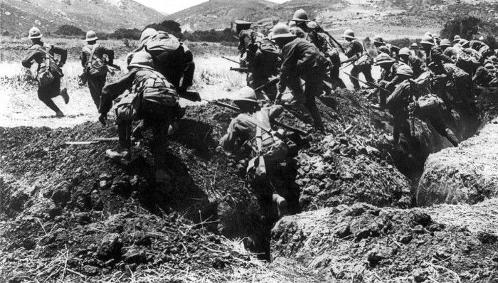 Infantry from the British Royal Naval Division in training on the Greek island of Lemnos during the Battle of Gallipoli, 1915. Men of the Royal Naval Division leaving the trenches in Gallipoli to attack the Turk with cold steel. On the extreme left the officer is seen leading the attack, while the hills in the background are typical of the difficult country to be traversed before Constantinople falls to Allies.Before and contemporary with Marines, many navies had Infantry like Naval…